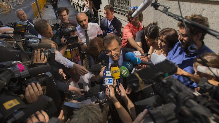 Ashya King parents' lawyer, Juan Isidro Fernandez Diaz, talks to the media outside the National court in Madrid, Spain, Monday, Sept. 1, 2014. Critically-ill 5-year-old boy Ashya King driven to Spain by his parents, Brett and Naghemeh, against doctors' advice is receiving medical treatment for a brain tumor in a Spanish hospital as his parents await extradition to Britain, police said Sunday. Officers received a phone call late Saturday from a hotel east of Malaga advising that a vehicle fitting the description circulated by police was on its premises. Both parents were arrested and the boy, Ashya King, was taken to a hospital, a Spanish police spokesman said. (AP Photo/Andres Kudacki)