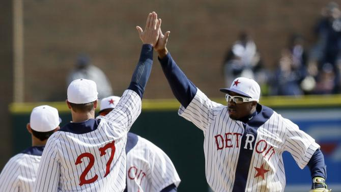 Detroit Tigers center fielder Rajai Davis, right, and third baseman Andrew Romine (27) celebrate their 4-1 win over the Cleveland Indians in a baseball game, Saturday, April 25, 2015, in Detroit. (AP Photo/Carlos Osorio)