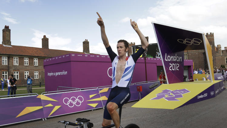 Britain's gold medalist Bradley Wiggins celebrates after winning the men's individual time trial cycling event at the 2012 Summer Olympics, Wednesday, Aug. 1, 2012, in London. (AP Photo/Lefteris Pitarakis)