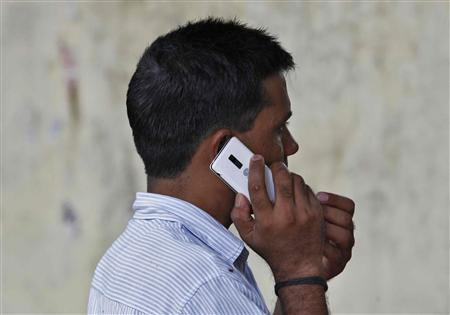 Man speaks on a mobile phone at a marketplace in New Delhi