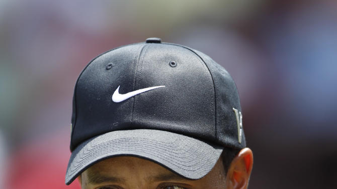 Tiger Woods of the United States looks on the ninth hole during the final of CIMB Classic golf tournament at the Mines Resort and Golf Club in Kuala Lumpur, Malaysia, Sunday, Oct. 28, 2012.  (AP Photo/Vincent Thian)
