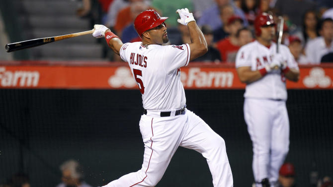 FILE - In this May 16, 2012, file photo, Los Angeles Angels' Albert Pujols watches his three-run home run against the Chicago White Sox during the third inning of a baseball game in Anaheim, Calif. Despite shocking many by struggling at the plate in his first season with Los Angeles, Pujols' batting average has risen since the start of May, and is showing that his swing may be turning the corner on his uncharacteristically low numbers. (AP Photo/Chris Carlson, File)