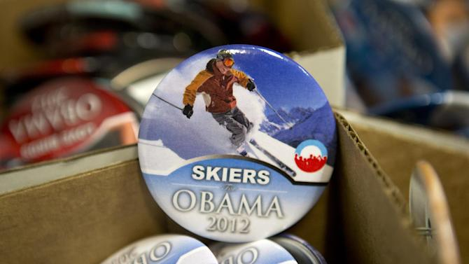 """A large variety of pins, including """"Skiers for Obama 2012"""" are for sale among the inauguration memorabilia at the Official Inaugural Store in Washington, Friday, Jan. 11, 2013. (AP Photo/Jacquelyn Martin)"""