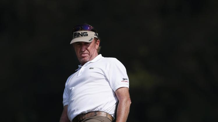 Defending champion Miguel Angel Jimenez from Spain reacts after missing a putt on the 10th green during the second day of the European Tour Hong Kong Open golf tournament