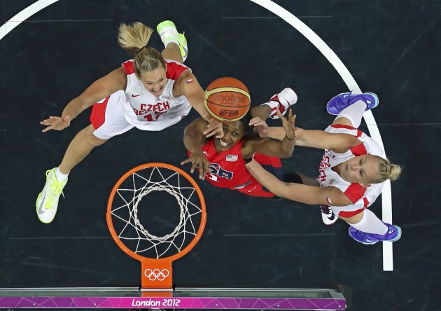 Czech Republic's Zrustova, teammate Kulichova and Cash of the U.S. reach for the rebound during their women's preliminary round Group A basketball match at the Basketball Arena during the London 2012