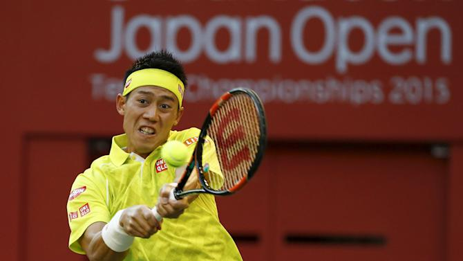 Japan's Kei Nishikori returns the ball to Sam Querrey of the U.S. during his men's singles tennis match at the Japan Open championships in Tokyo