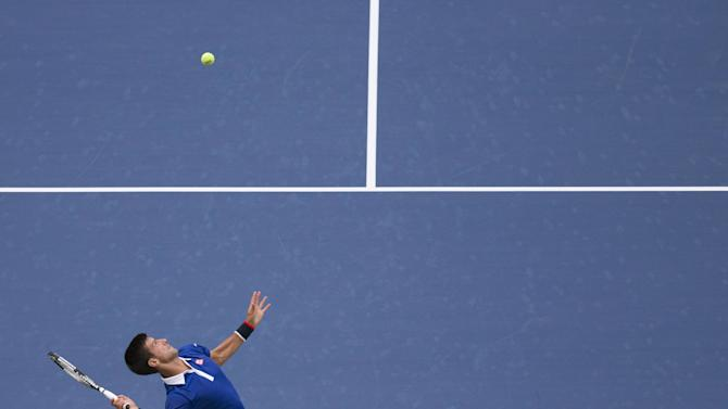 Djokovic of Serbia serves to Souza of Brazil during their match at the U.S. Open Championships tennis tournament in New York