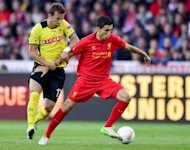 Liverpool's midfielder Nuri Sahin (R) fights for the ball with Young Boys' defender Elsad Zverotic during their Europa League group A football match in Bern. Liverpool won 5-3
