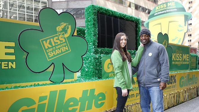 "IMAGE DISTRIBUTED FOR GILLETTE - Football star Brian Westbrook, right, with a Gillette Brand Ambassador, shaved his signature goatee to declare ""Kiss Me, I'm Smooth Shaven!"" onboard the Gillette float at the St. Patrick's Day Parade in Philadelphia, reminding guys to K.I.S.S.--Keep It Smooth Shaven-- on Sunday, March 30, 2013. A recent study revealed that 85% of women prefer to kiss a man who is smooth shaven, and that two out of three women said men will have better luck with them if they are stubble-free. (Photo by Mark Stehle/Invision for Gillette/AP Images)"