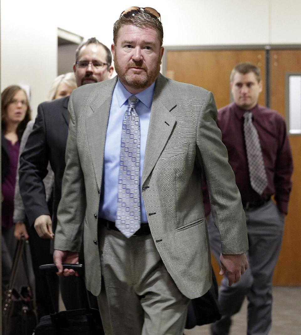 Defense attorney Daniel King leads his team to court for the third day of a preliminary hearing for Aurora theater shooting suspect James Holmes at the courthouse in Centennial, Colo., on Wednesday, Jan. 9,  2013. (AP Photo/Ed Andrieski)