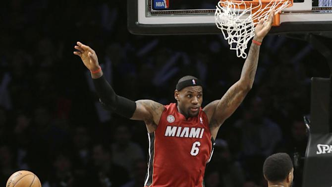 Miami Heat forward LeBron James (6) reacts after dunking during the second half of an NBA basketball game against the Brooklyn Nets, Wednesday, Jan. 30, 2013, in New York. The Heat won 105-85. (AP Photo/Kathy Willens)