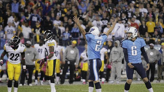 Tennessee Titans kicker Rob Bironas (2) and holder Brett Kern (6) react after Bironas' game-winning field goal in the fourth quarter of an NFL football game against the Pittsburgh Steelers on Friday, Oct. 12, 2012, in Nashville, Tenn. The Titans won 26-23. (AP Photo/Wade Payne)