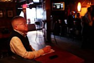 Henry Smith, who hopes to marry his partner later this year, enjoys a drink at the Stonewall Inn, a historic gay bar in Greenwich Village, just after President Barack Obama announced that same sex couples should be able to get married, in New York City