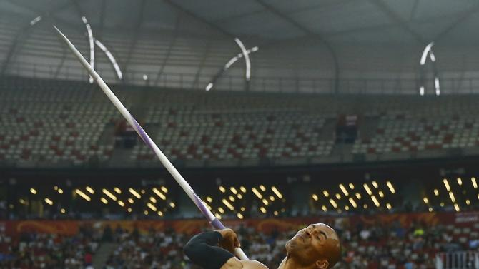Warner of Canada competes in the javelin throw event of the men's deacthlon at the 15th IAAF World Championships at the National Stadium in Beijing