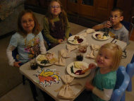 Children eating Thanksgiving dinner together.