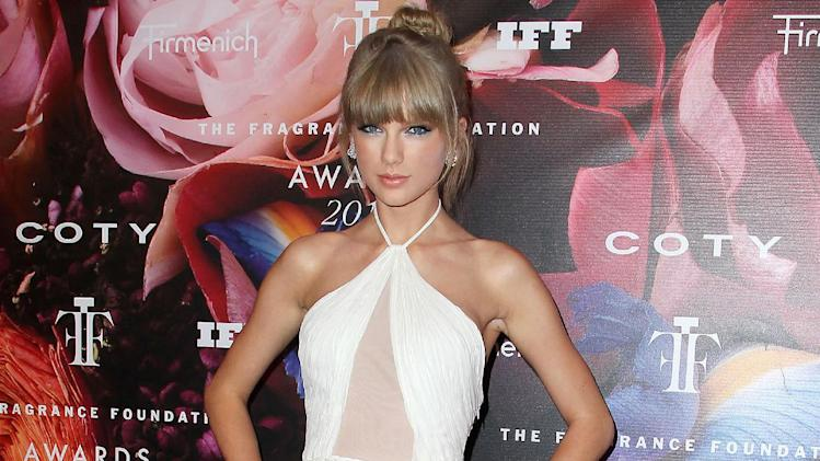 This June 12, 2013 photo released by Starpix shows singer Taylor Swift at The Fragrance Foundation Awards at Lincoln Center's Alice Tully Hall in New York. Swift was honored as Fragrance Celebrity of the Year at the Fragrance Awards. She has three signature fragrances, including the recently released Taylor by Taylor Swift. In 2011, her Wonderstruck was the top-selling celebrity fragrance. (AP Photo/Starpix, Amanda Schwab)