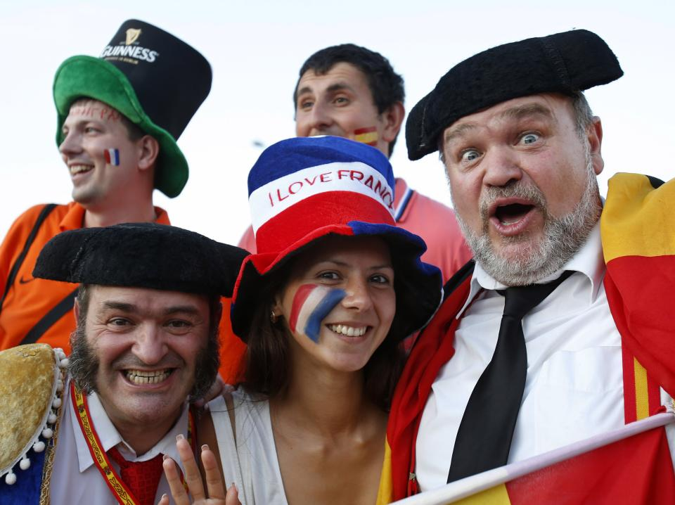 Soccer fans wait for the start of the Euro 2012 soccer championship quarterfinal match between Spain and France in Donetsk, Ukraine, Saturday, June 23, 2012. (AP Photo/Darko Vojinovic)