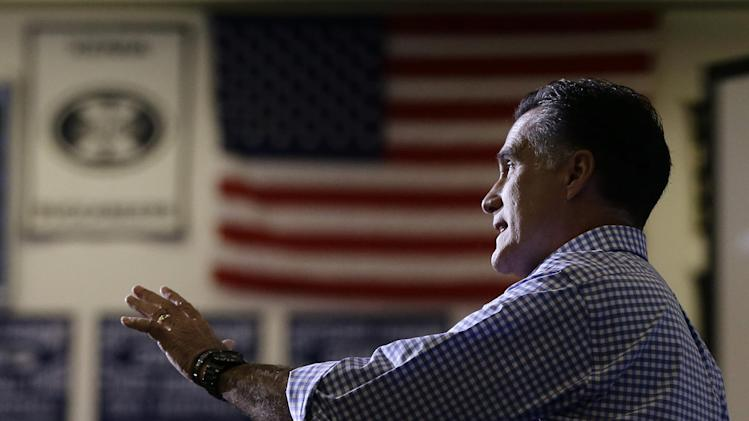 Republican presidential candidate, former Massachusetts Gov. Mitt Romney speaks to audience members as he participates in a campaign event collecting supplies from local relief organizations for victims of superstorm Sandy, Tuesday, Oct. 30, 2012, at the James S. Trent Arena in Kettering, Ohio. (AP Photo/Charles Dharapak)