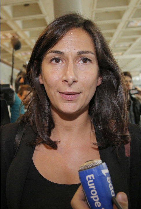 French lawyer Delphine Pando for Closer magazine leaves the court in Nanterre, on the outskirts of Paris, Monday, Sept, 17, 2012 where lawyers for the British royal family sought an injunction against