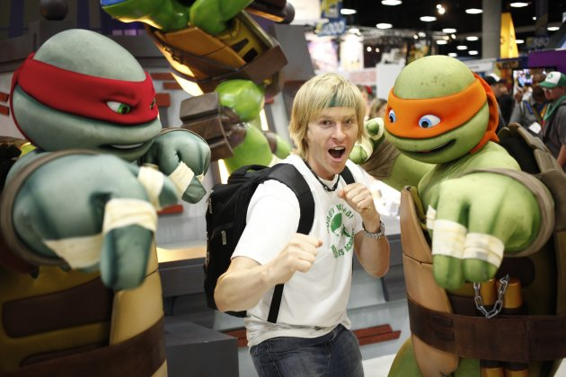 COMMERCIAL IMAGE - A fan poses for a photo with teenage mutant ninja turtles at the Nickelodeon booth at Comic-Con on Thursday, July 12, 2012, in San Diego, Calif. (Photo by Joe Kohen/Invision for Nic
