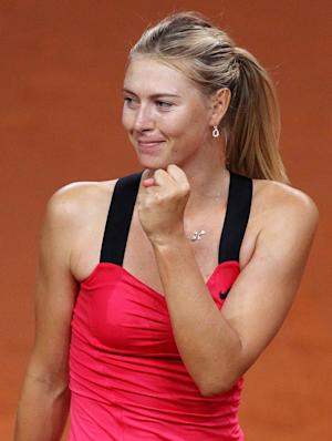 Russia's Maria Sharapova reacts after beating Czech Petra Kvitova 6-4, 7-6 during their semifinal match at the Porsche Tennis Grand Prix in Stuttgart, Germany, Saturday, April 28, 2012. (AP Photo/Michael Probst)