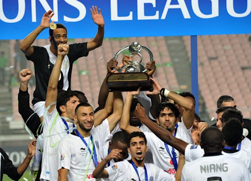 Qatar's Al Sadd players celebrate with the trophy after winning the AFC Champions League football final against South Korea's Jeonbuk Hyundai Motors in Jeonju, some 200 kms south of Seoul, on November 5, 2011. Qatar's Al Sadd beat South Korea's Jeonbuk Hyundai Motors 4-2 in a dramatic penalty shoot-out to win the AFC Champions League title.  AFP PHOTO / KIM JAE-HWAN (Photo credit should read KIM JAE-HWAN/AFP/Getty Images)