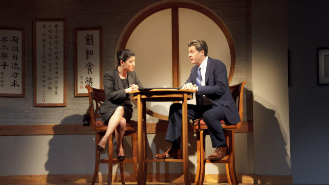 "In this theater image released by Jeffrey Richards Associates, Jennifer Lim, left, and Gary Wilmes are shown during a performance of ""Chinglish,"" in New York. Plans are in the works to bring David Henry Hwang's ""Chinglish"" to a movie screen. The filmmaker Justin Lin, who has directed several of the ""Fast and Furious"" movies, announced Tuesday, April 24, 2012, that he has acquired film rights to Hwang's play about an East-meets-West collision.  (AP Photo/Jeffrey Richards Associates, Michael McCabe)"