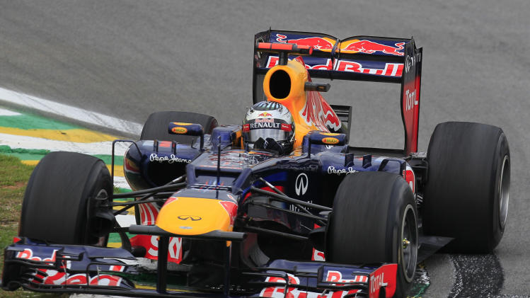 Red Bull driver Sebastian Vettel of Germany steers his car during a free practice at the Interlagos race track in Sao Paulo, Brazil, Saturday, Nov. 24, 2012. Brazil's Formula One Grand Prix will take place Sunday. (AP Photo/Ricardo Mazalan)
