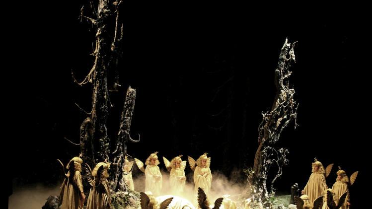 In this undated, publicly provided picture by Volksoper Vienna, children  dressed as angels perform during a rehearsal of the opera Hansel and Gretel, by composer Engelbert Humperdinck in the Volksoper opera in Vienna.  (AP Photo/HONS/ Barbara Palffy,Volksoper Vienna)