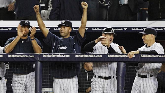 New York Yankees' Alex Rodriguez, left, Derek Jeter, second from left, and manager Joe Girardi, right, celebrate their 14-2 win over the Boston Red Sox in a baseball game, Wednesday, Oct. 3, 2012, in New York. The Yankees clinched the American League East title. (AP Photo/Frank Franklin II)