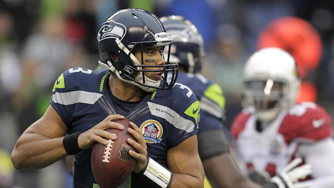 Seattle Seahawks quarterback Russell Wilson (3) passes against the Arizona Cardinals during the first half of an NFL football game in Seattle, Sunday, Dec. 9, 2012. (AP Photo/Stephen Brashear)