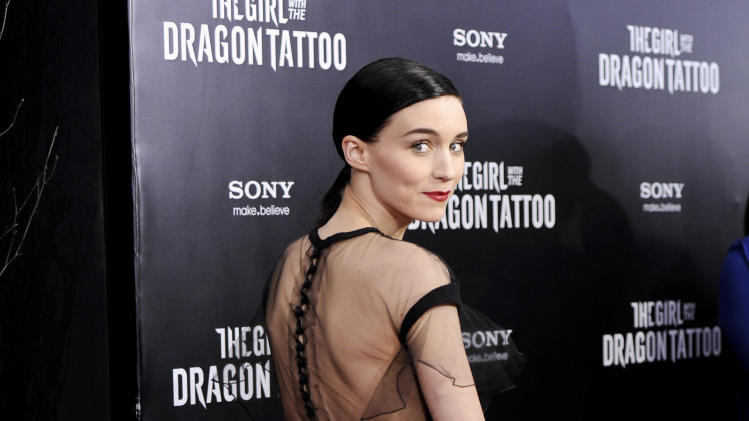 "Actress Rooney Mara attends the premiere of ""The Girl With The Dragon Tattoo"" at the Ziegfeld Theatre on Wednesday, Dec. 14, 2011 in New York. (AP Photo/Evan Agostini)"