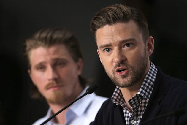 Actor Justin Timberlake, right, speaks as actor Garrett Hedlund listens during a press conference for Inside Llewyn Davis at the 66th international film festival, in Cannes, southern France, Sunday, M