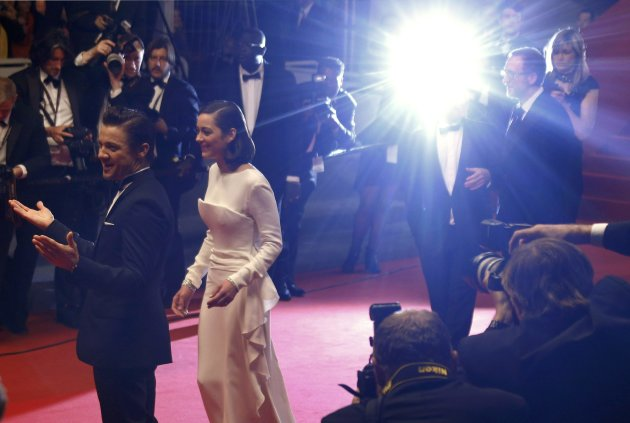 "Cast members Renner and Marion Cotillard leave after the screening of the film ""The Immigrant"" in competition during the 66th Cannes Film Festival"