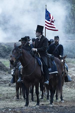 "This undated publicity photo provided by DreamWorks and Twentieth Century Fox shows Daniel Day-Lewis as President Abraham Lincoln looking across a battlefield in the aftermath of a terrible siege in this scene from director Steven Spielberg's drama ""Lincoln."" A familiar lineup of Hollywood awards contenders are expected among Golden Globe nominations coming out Thursday morning, Dec. 13, 2012, whose prospects include past Oscar winners Daniel Day-Lewis, Helen Mirren, Robert De Niro and Sally Field. Other Oscar recipients may be nominated, such as Mirren and Anthony Hopkins for ""Hitchcock,"" Philip Seymour Hoffman for ""The Master,"" Helen Hunt for ""The Sessions,"" Marion Cotillard for ""Rust and Bone,"" Russell Crowe for ""Les Miserables"" and Alan Arkin for ""Argo.""  (AP Photo/DreamWorks, Twentieth Century Fox, David James)"