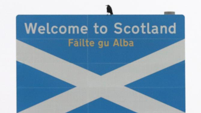 """A view of the """"welcome to Scotland"""" sign at the border of Engalnd and Scotland at Berwick Upon Tweed, Scotland, Tueday, Sept. 16, 2014. The two sides in Scotland's independence debate are scrambling to convert undecided voters, with just two days to go until a referendum on separation. Anti-independence campaigners are pushing home their message that a """"No"""" vote doesn't mean the status quo. The three main British political parties are promising Scotland greater powers, including tax-raising authority, if it remains part of the United Kingdom. The Yes campaign says the promises are vague and reveal the No side's desperation, with polls suggesting the outcome will be close. Scottish Deputy First Minister Nicola Sturgeon said """"the only way to guarantee the real powers we need in Scotland is to vote Yes."""" (AP Photo/Scott Heppell)"""