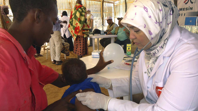 A Turkish doctor examines a Somali child from southern Somalia in Mogadishu, Somalia, Wednesday, Sept.14, 2011. A massive aid operation is currently underway to help millions of Somalis affected by the fighting and a famine caused by severe drought.(AP Photo/Ali Bashi)