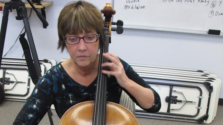 In this Nov. 17, 2012, photo, Pati Crofut practices the cello with the Hiland Mountain Correctional Facility Orchestra in Eagle River, Alaska. Crofut, director of the Anchorage-based Arts on the Edge, founded the orchestra in 2003. (AP Photo/Mark Thiessen)
