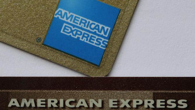 In this Tuesday, Jan. 17, 2012 photo, two American Express cards are shown in Surfside, Fla. American Express Co., releases quarterly financial results Thursday, Jan. 19, 2012, after the market close. (AP Photo/Wilfredo Lee)
