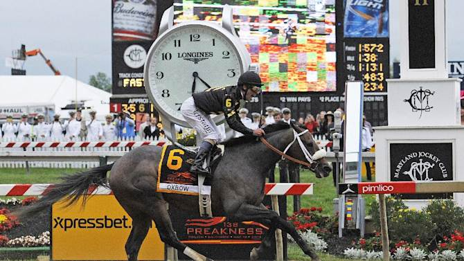 Oxbow, ridden by jockey Gary Stevens, wins the 138th Preakness Stakes horse race at Pimlico Race Course, Saturday, May 18, 2013, in Baltimore. (AP Photo/Mike Stewart)