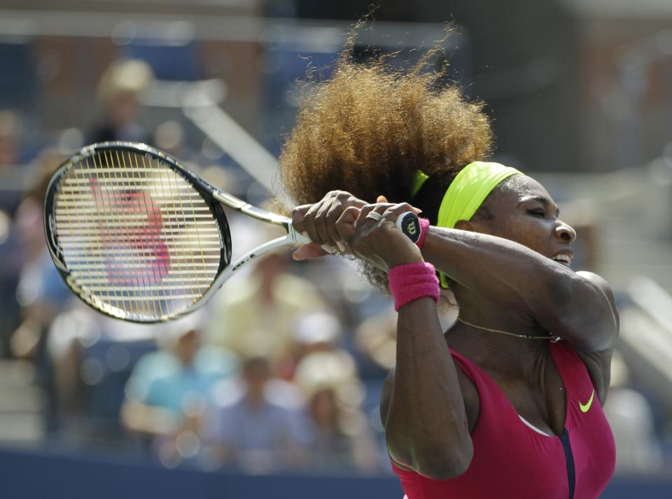 Serena Williams returns a shot to Russia's Ekaterina Makarova in the third round of play at the 2012 US Open tennis tournament,  Saturday, Sept. 1, 2012, in New York. (AP Photo/Kathy Willens)