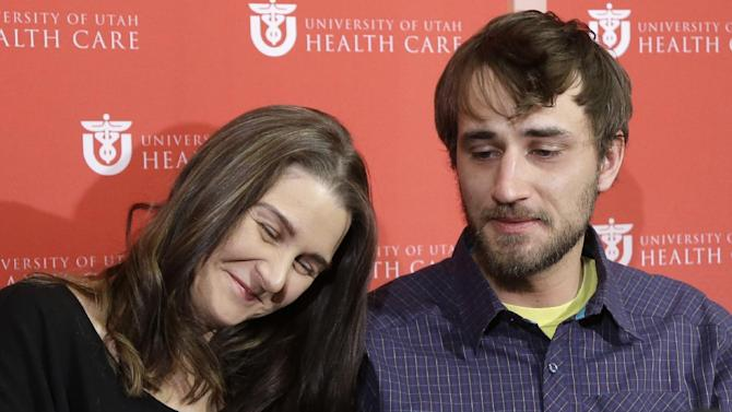 Avalanche survivor, Elisabeth Malloy and skiing partner and initial rescuer Adam Morrey discuss their avalanche ordeal during a news conference at the University of Utah Health Care's Burn Center Wednesday, Jan. 16, 2013, in Salt Lake City. Malloy suffered frost bite in her toes and fingers, but emerged otherwise unscathed from Saturday's near-death encounter in the mountains east of Salt Lake City. She survived thanks to her boyfriend, Adam Morrey, avalanche rescue beacons, a skier that wandered by and avalanche rescue teams.  (AP Photo/Rick Bowmer)