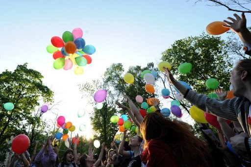 <p>Russian gay rights activists launch balloons during an event in Moscow in May. Seventy-three people have been prosecuted for violating new anti-gay legislation imposed in Russia's former imperial city Saint Petersburg four months ago, police said.</p>