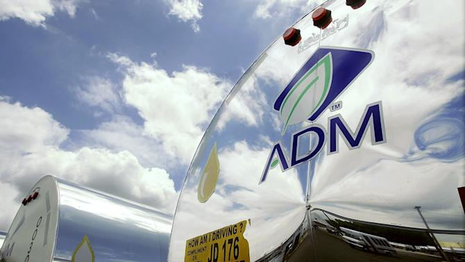 FILE - In this July 2, 2009 file photo, the ADM logo is seen on a tanker truck which carries mostly corn syrup at the Archer Daniels Midland Company plant in Decatur, Ill. Agribusiness conglomerate Archer Daniels Midland Co. announced Monday, Dec. 3, 2012, it is increasing its buyout offer for GrainCorp by almost 4 percent and disclosed it has already added to its stake in the Australian grain handler. (AP Photo/Seth Perlman, file)