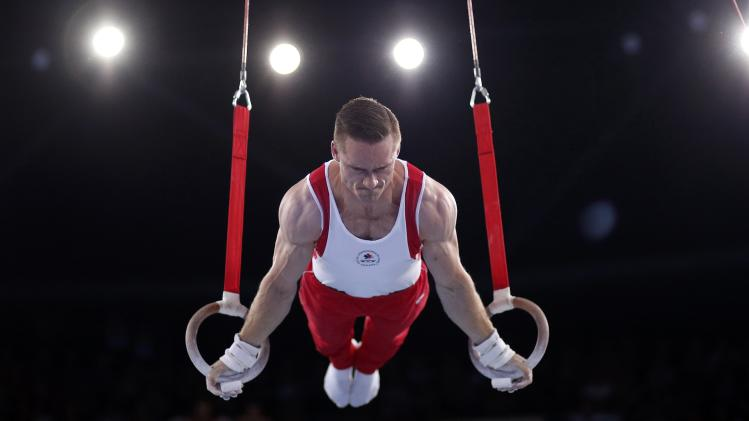 Morgan of Canada performs on the rings during the men's gymnastics apparatus final at the 2014 Commonwealth Games in Glasgow
