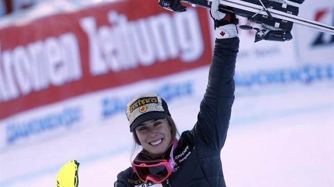 Canada's Marie-Michele Gagnon celebrates after winning a women's alpine ski World Cup super-combined event, in Altenmarkt-Zauchensee, Austria, Sunday, Jan. 12 , 2013. (AP Photo/Marco Trovati)