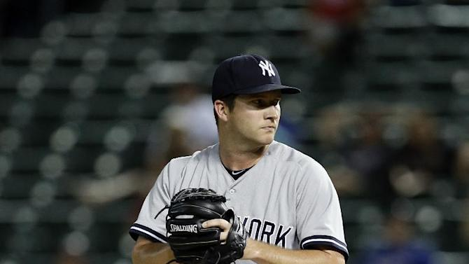 New York Yankees relief pitcher Adam Warren winds up to deliver to the Texas Rangers in a baseball game Tuesday, July 28, 2015, in Arlington, Texas. (AP Photo/Tony Gutierrez)