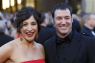 "Director Mark Andrews and producer Katherine Sarafian of the film ""Brave"" arrive at the 85th Academy Awards in Hollywood, California February 24, 2013 REUTERS/Adrees Latif"