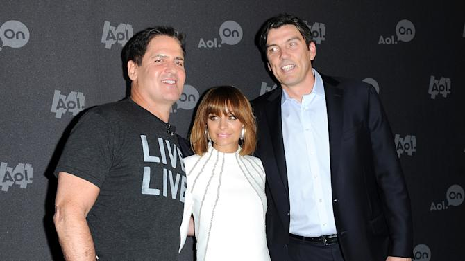 "Entrepreneur Mark Cuban, from left, Nicole Richie and AOL CEO Tim Armstrong attend AOL's web series ""NewFront"" at Moynihan Station on Tuesday April 30, 2013 in New York. (Photo by Evan Agostini/Invision/AP)"