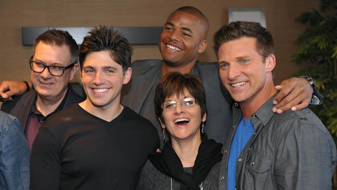 "Jill Farren Phelps, second from right, executive producer of ""The Young and the Restless,"" poses with, from left, the show's head writer Josh Griffith and cast members Robert Adamson, Redaric Williams and Steve Burton at the Hot New Faces of ""The Young and the Restless"" press junket at CBS Television City on Wednesday, Feb. 27, 2013 in Los Angeles. The CBS show, daytime's top-rated soap since December 1988, hits the big 4-0 on Tuesday, March 26, 2013. (Photo by Chris Pizzello/Invision/AP)"